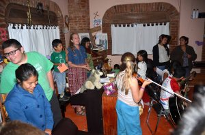 The Zaragoza children singing with their mom, Julie